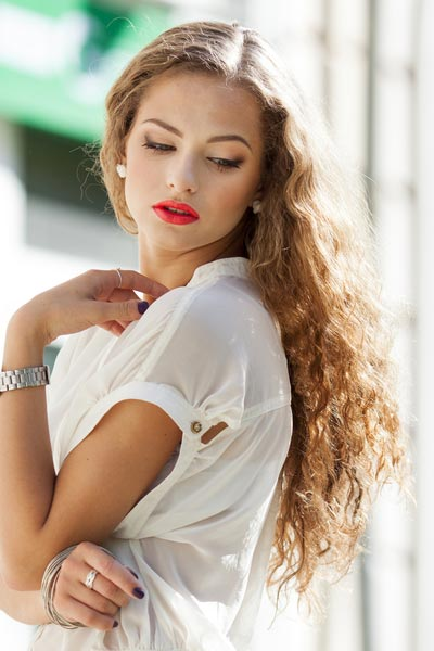 30 schmeichelhafteste Haarschnitte für langes gewelltes Haar