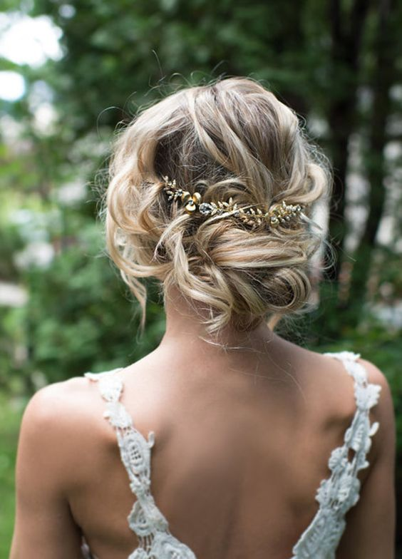 20 most beautiful bridal updos for elegant brides haircuts low updo shinny leaf hairpiece junglespirit Choice Image