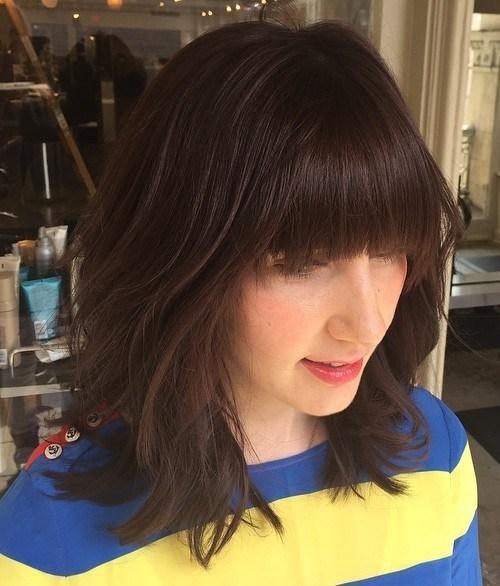 Medium Shag Haircut with Blunt Bangs