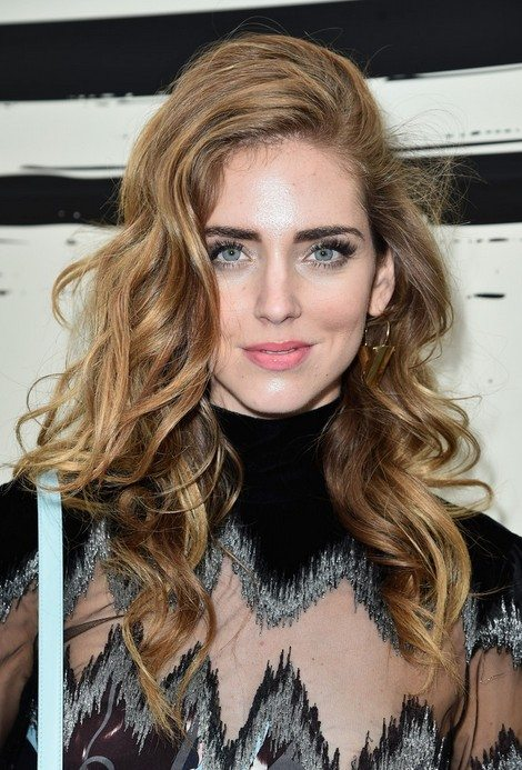 Side Swept Curly Hairstyle