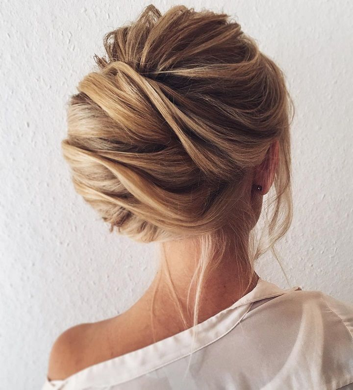 Chignon Bun With Loose Strands of Hair