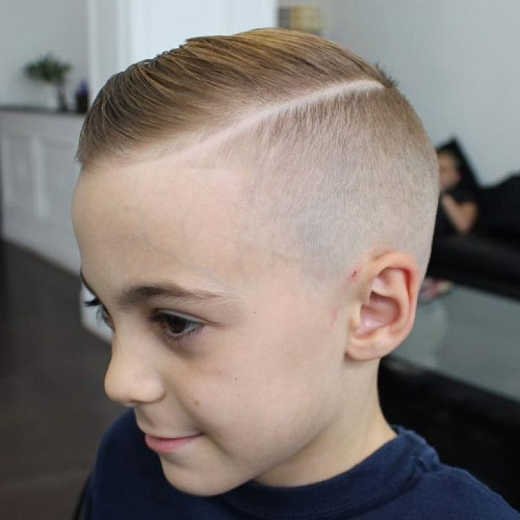 1. Comb Over Hair with Hard Part and Skin Fade