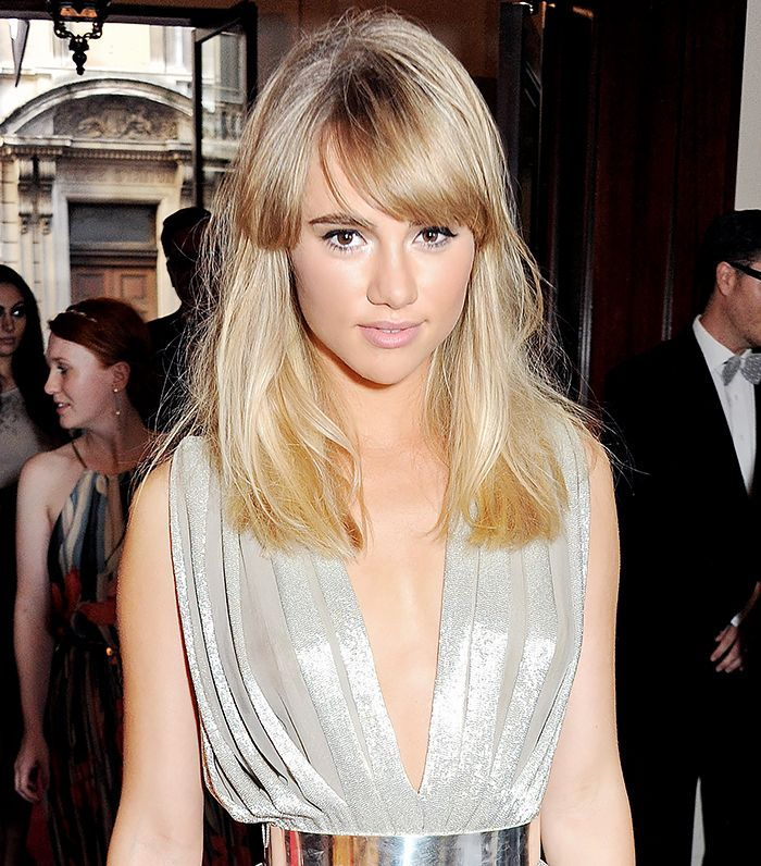9. Medium Hairstyle with Parted Fringe